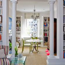 Grand Pillars Create A Clear Divide Between The Living Room And Dining Without Separating