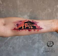 Animals Of Africa Silhouette Watercolor Piece On Girls Forearm Tattoo By Koray Karagozler An Artist Based In Antalya Turkey