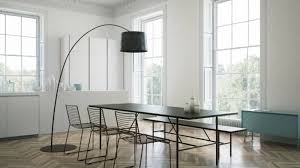 Minimalist Dining Room With Simple Furniture And An Arc Floor Lamp
