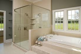 Small Beige Bathroom Ideas by White Bathtub With Beige Tile Stair Connected By Glass Shower