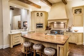 Hardwood Floors Chimney Range Hood Beige Theme Rustic Kitchen With Butcher Block Countertop Island