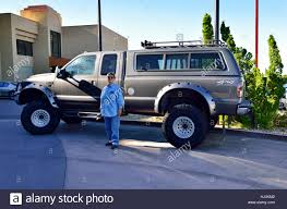 Woman Standing Next To A Large Ford Triton V10 F350 Super Duty Off ... Ford To Cut F150 And Large Suv Production Increase For Small 2018 Toyota Sequoia Tundra Fullsize Pickup Truck Trd 2016 Gmc Pickups A Size Every Need Chicago Car Guy Used Cars Trucks Glendive Sales Corp Whosale Dealer Mt 2007 Nissan D22 25 Di 4x4 Single Cab Pick Up Truck Amazing Runner 2012 F450 Dump Together With Insert For Sale The 1993 Silverado Is Large Pickup Truck Manufactured By Brabus G500 Xxl Is Very Wide Cool Offroad Full Traing Highly Raised Debary Miami Orlando Florida Panama Startech Range Rover Filled With Tires Driving On The Freeway