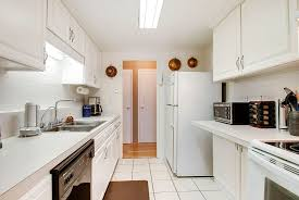 white cabinets with bianco antico granite birdcage cabinet knobs