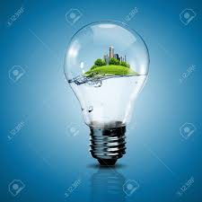 electric light bulb and a plant inside it as symbol of green