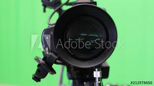 TV Camera In The Studio With Green Screen Background News And Broadcasting Concept