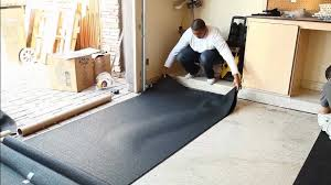 Floating Floor Underlayment Basement by Garage Flooring Inc Installs Rubber Underlayment Youtube