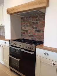 Kitchen Cooker Alcove With Exposed Brick And Wooden Beam