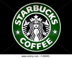 Starbucks Coffee Sign With A Black Background