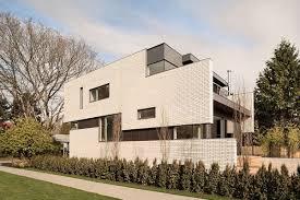 100 Contemporary House Facades This Vancouver Home Wows With A White Brick Faade And Bamboo Garden