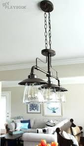 Lowes Kitchen Island Lighting Trio Of Industrial Lights From Over This Wooden Dining Room Table