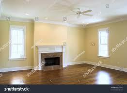 empty living room granite fireplace windows stock photo 8569846
