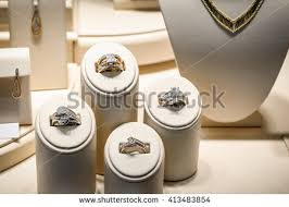 Picture Of A Jewelry Store Beige Window Display Stands With Gold Diamond Rings Necklaces