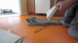 Laying Vinyl Tile Over Linoleum by Flooring How To Lay Vinyl Tile On Woodloor Uneven Videolooring