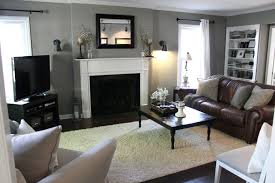 warm living room design with black iron frame fireplace and brown