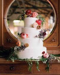 Rustic Vintage Wedding Cake Featuring Colorful Floral Decorations And Greenery