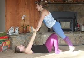 Two Girls Practicing Acro Yoga