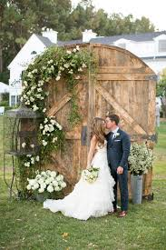 Love The Rustic Barn Doors For A Wedding Backdrop They Can Switch Up Flowers To Their Scheme