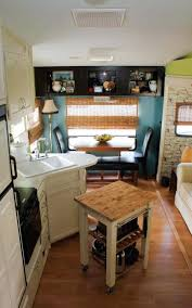 Couple Renovate 5th Wheel Travel Trailer Into Tiny Home Photo LOVE The Light Kitchen Cabinets