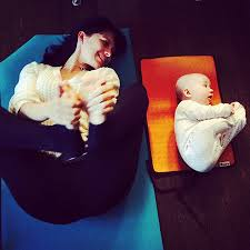 Hilaria Baldwin Doing Yoga With Baby Carmen Happy Pose