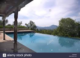 100 Infinity Swimming Blue Infinity Swimming Pool In Garden Of Italian Country Villa Stock
