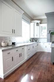 kitchen backsplash white cabinets black countertop tile pictures