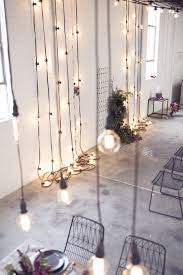 industrial hanging bare light bulbs warehouse wedding industrial