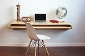 Home Office In Apartment Small Space Features Floating Designer ... Modern Standing Desk Designs And Exteions For Homes Offices Best 25 Home Office Desks Ideas On Pinterest White Office Design Ideas That Will Suit Your Work Style Small Fniture Spaces Desks Sdigningofficessmallhome Fresh Computer 8680 Within Black And Glass Desk Chairs Reception Metal Frame For The Man Of Many Cozy Corner With Drawers Laluz Nyc Elegant