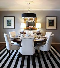 Luxury Dining Room Lighting Using Drum Shade Table Lamp And Black Pendant Light Over Rounded Set
