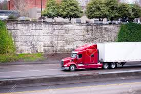 A Profile Of A Huge Red American Big Rig Semi Truck With A Raised ...