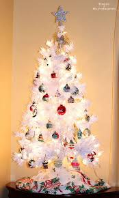 A White Christmas Tree With Vintage Shiny Brite Ornaments Creates Modern Retro Holiday Look That