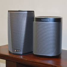 sonos vs denon heos which wireless speaker system stands