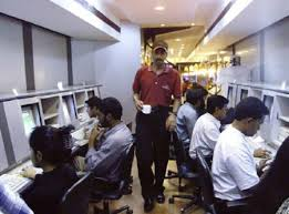 A Waiter Serves Coffee To College Students Surfing The Internet At Cafe In Bangalore This April 6 2000 File Photo REUTERS Stringer Files