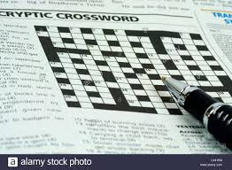Pen on top of the crossword puzzle section of a newspaper Stock