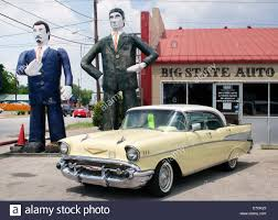100 281 Truck Sales Giant Art Dudes Outside A Car Dealer In Houston Texas Stock