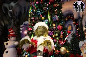 The Grinch Christmas Tree Star by Behind The Thrills Peeking Under The Tree Universal Orlando