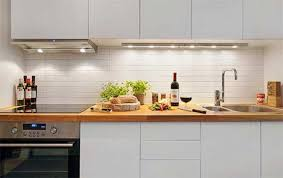 Kitchen Minimalist White Apartment Design Space Wooden Countertop Cabinet Lamps Under Backpalsh Stove Tile