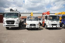 White Hyundai Flatbed Trucks With Yellow, Red, Black Crane Arm ... Various Old Articuated Tractor And Flatbed Trucks At Smallwood Stock 1995 Mack Rd690s W 206 Steel Flatbed Trailer 2017 Intertional 4300 Truck For Sale 752 Miles Used Trucks For Sale Loading Saferack Man Stands On Roadside Editorial Photography Image Truck Wikipedia Tommy Gate Liftgates For Flatbeds Box What To Know 2011 Intertional 4400 Truck In New Jersey Isuzu 10665 Economy Mfg