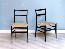 Two Simple Black Kitchen Or Dining Chairs With Woven Wicker Seats.. Lotta Ding Chair Black Set Of 2 Source Contract Chloe Alinum Wicker Lilo Chairblack Rattan Chairs Uk Design Ideas Nairobi Woven Side Or Natural Flight Stream Pe Outdoor Modern Hampton Bay Mix And Match Brown Stackable