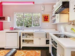 Adorable Kitschy Kitchen With Pink Accents Is Perfect For A Girls Getaway