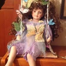Fine Porcelain Enchanted Garden Doll On Swing