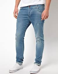 asos skinny jeans with worn rips in blue for men lyst mens