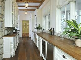 Top White Country Galley Kitchen With Natural Wood Countertops While Many
