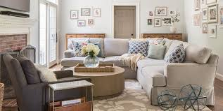 light gray skirted sectional with wood coffee table