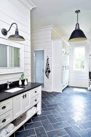 black and white cottage mudroom is clad in slate herringbone