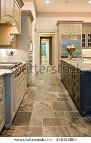 Expensive Kitchen With Slate Floors And Mixed Wood