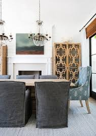 Gorgeous Dining Room Features A Pair Of Paris Flea Market Chandelier Over Blond Wood Table Lined With Charcoal Gray Slipcovered Chairs As