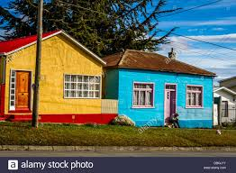 100 Houses In Chile Person Sitting On Doorstep Of A Brightly Coloured Houses In Vivid