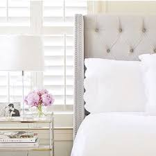 a tufted wingback headboard is a classic bedroom piece that will