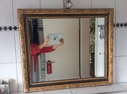 goldener spiegel holzrahmen facettenschliff