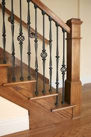 Stairway features and Iron Balusters with and Iron Baluster Collars Box Newel Handrail